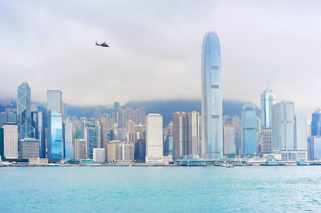 helicopter: Flying helicopter above the Hong Kong downtown Stock Photo