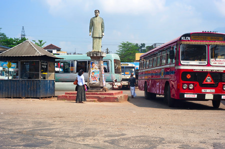 regular people: BATTICALOA, SRI LANKA - FEB 18, 2011: People at a public bus station. There are two kinds of public buses in Sri Lanka: government (SLTB) and private