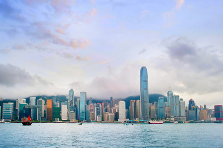harbors: Wide angle panorama of Hong Kong at sunset Editorial