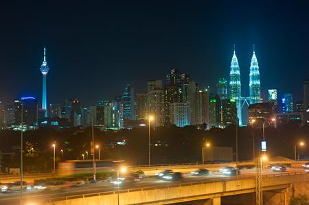 kl: NIght traffic in Kuala Lumpur. Skyline of KL on the background. Malaysia
