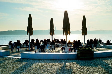 many people: People in outdoor restaurant on embankment of Lisbon, Portugal Stock Photo