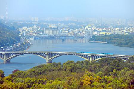Aerial view of Metro bridge, Pedestrian bridge and Podil district on the background. Kiev, Ukraine