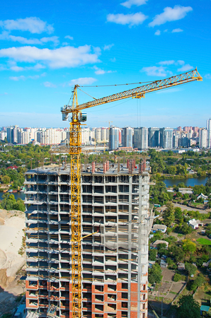 rise: Aerial view of construction site with crane and workers in progress. Kiev, Ukraine Stock Photo