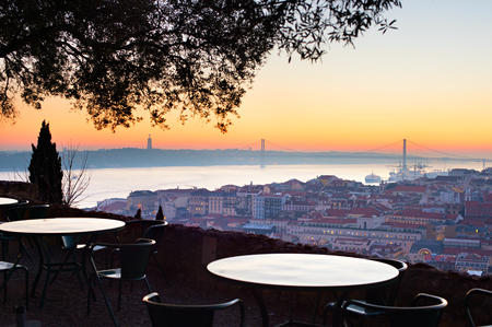 fantastic view: Outdoor restaurant with fantastic view of Lisbon at sunset. Portugal Stock Photo
