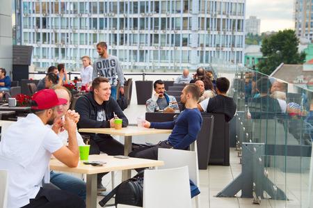 drinks on bar: KIEV, UKRAINE - SEPT 21, 2015: People at rooftop restaurant in Kiev. Kiev is the capital and business centre of Ukraine.
