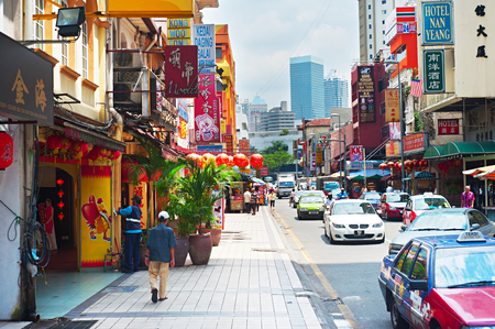 populous: KUALA LUMPUR, MALAYSIA - MARCH 20, 2012: Chinatown street in Kuala Lumpur. KL is the capital and most populous city in Malaysia. Covers an area of 243 km2 and has population of 1.6 million in 2012