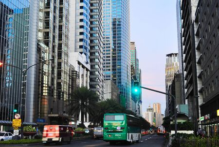 MANILA, PHILIPPINES - APRIL 02, 2012: Traffic on a road in  Makati city in Metro Manila, Philippines. Makati - business center and one of the 17 cities that make up Metro Manila. Editorial