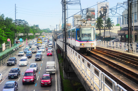 MANILA, PHILIPPINES - APRIL 03, 2012: LRT train on a railroad in Manila, Philippines. LRT serves 579,000 passengers each day. Its 31 stations along over 31 kilometers Editorial