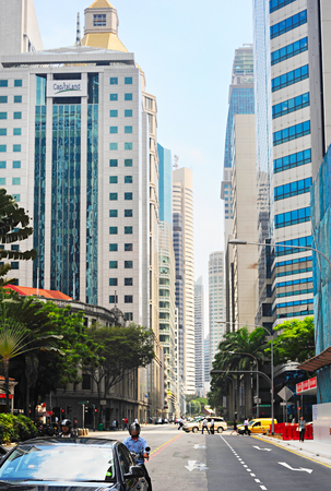 highway traffic: SINGAPORE - MARCH 05, 2013: Traffic on a road at Singapore Downtown Core.The Downtown Core is a 266-hectare urban planning area in the south of the city-state of Singapore.