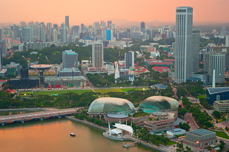 esplanade: Skyline of Singapore at colorful dusk. View from above