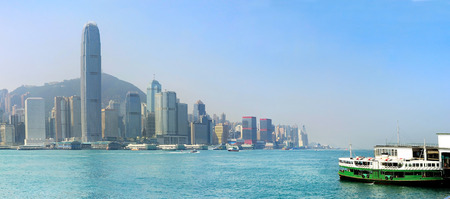 hong kong island: Panoramic view of Hong Kong island with ferry boat from Kowloon island
