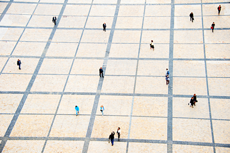 birds eye view: People walking on the Sofiyivsky square in Kiev, Ukraine. motion blur