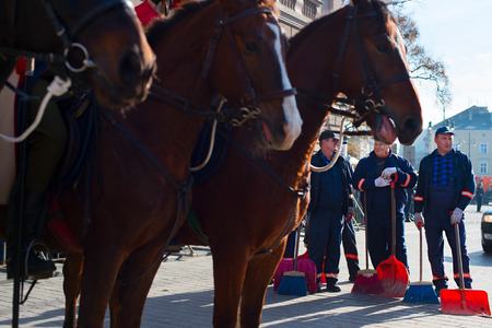service occupation: KRAKOW, POLAND - NOV 11, 2014: Cleaners on the street during the National Independence Day an Republic of Poland - is a holiday, celebrated every year from 1918 year.