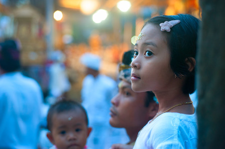 people   lifestyle: UBUD, BALI ISLAND, INDONESIA - APril 29, 2011: Portrait of an unidentified Balinese girl during the Hindu ceremony. With a population  4,225,000  the island is home to most of Indonesias Hindu minority.