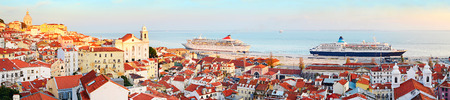 lisboa: Old town of Lisbon and two cruise ships in the port at sunset. Portugal