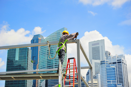Worker at construction site in front of Singapore downtown