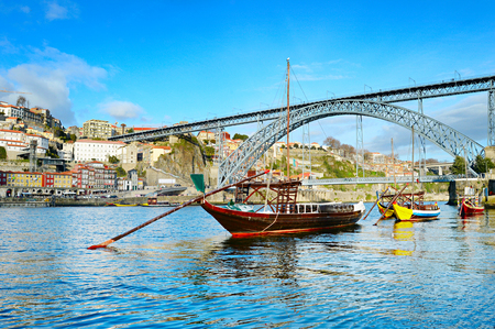 rabelo: Rabelo boats in front of Dom Luis II bridge in Porto, Portugal