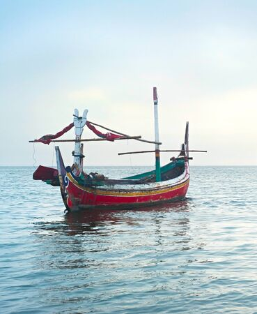 industry moody: Traditional indonesian fishing boats in the ocean, Jawa island, Indonesia
