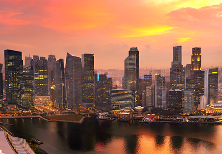 corporates: Skyline of Singapore Downtown Core colorful sunset sky Stock Photo