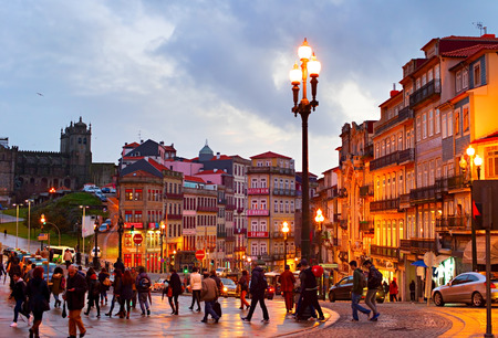proclaimed: PORTO, PORTUGAL - JAN 15, 2015: People walking on the Old Town street of Porto. Porto historical core was proclaimed a World Heritage Site by UNESCO in 1996 Editorial