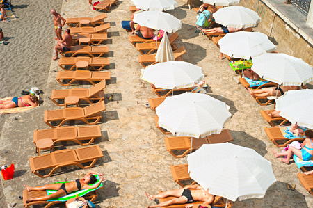 national geographic: SUDAK, UKRAINE - SEPT 08, 2015: People at a sea beach in Sudak. According to National Geographic, Crimea was among the top 20 travel destinations in 2013 Editorial