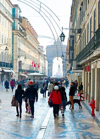 augusta: LISBON, PORTUGAL - DEC 24, 2014: People on Augusta street in the day.  Augusta Street with the Triumphal Arch - is the famous tourist attraction in Lisbon. Editorial