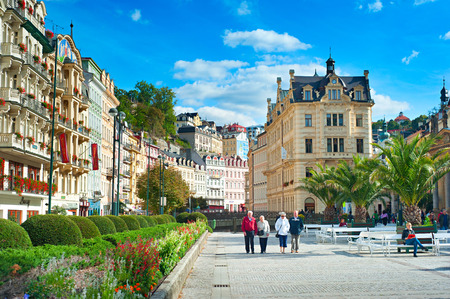 KARLOVY VARY, CZECH REPUBLIC - SEPTEMBER 20, 2012: People walking along Hot springs colonnade in Karlovy Vary. Karlovy Vary historically famous for its hot springs (13 main springs, about 300 smaller)