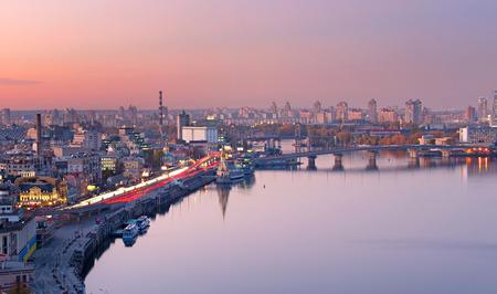 Beautiful Kiev skyline with reflection in Dnieper river at twilightk. Ukraine