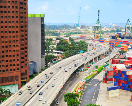 famous industries: Modern highway and commercial port with many containers in Singapore Stock Photo