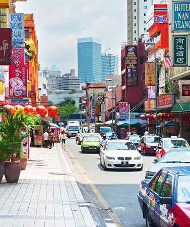 kl: KUALA LUMPUR, MALAYSIA - MARCH 20, 2012: Chinatown street in Kuala Lumpur. KL is the capital and most populous city in Malaysia. Covers an area of 243 km2 and has population of 1.6 million in 2012