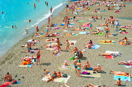 sudak: SUDAK, UKRAINE - SEPT 08, 2015: People at a sea beach in Sudak. According to National Geographic, Crimea was among the top 20 travel destinations in 2013 Editorial