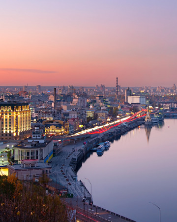 nighttime: Top view of Kiev with reflection in Dnieper river at dusk. Ukraine