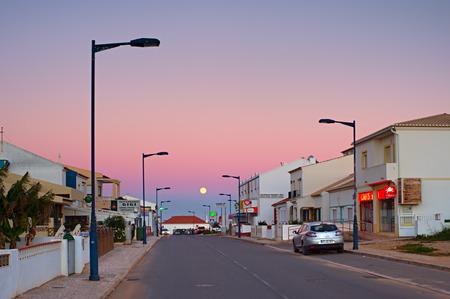 region of algarve: SAGRES, PORTUGAL - JANUARY 04,2016: Street of Portugal village at twilight in Sagres, Algarve region.  Algarve is the most popular tourist destination in Portugal. Almost 10 million people visit the Algarve annually.