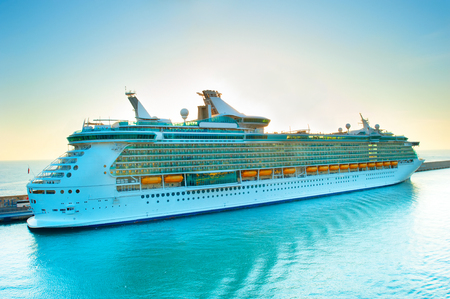 Luxury cruise liner in a port at sunset 版權商用圖片