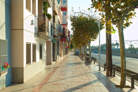 Beautiful sunny street of Barcelona suburb. Spain
