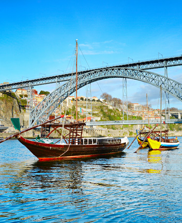 rabelo: Traditional Rabelo boats in front of Dom Luis II bridge. Porto, Portugal