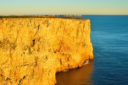 region of algarve: West ocean coast of Portugal at sunset. Algarve region