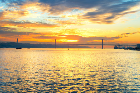 the tagus: Tagus river and 25 April bridge at dusk. Lisbon, Portugal