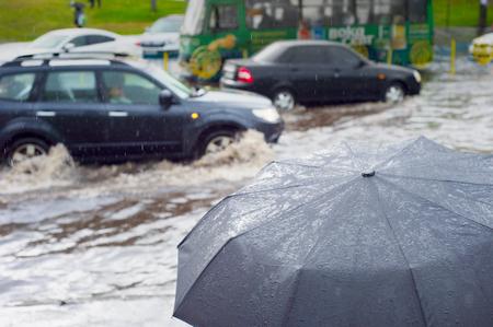 Heavy rain in the city. Sharpness on umbrella