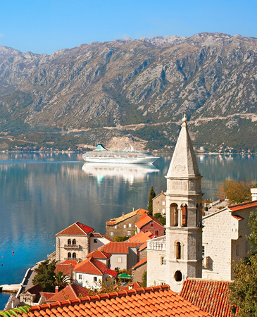 church of our lady: View on Perast town with Church Our Lady of the rocks and cruise liner. Montenegro