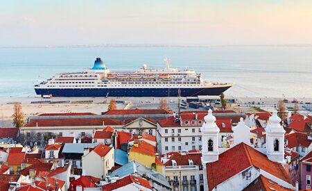 lisboa: Lisbon luxury cruise ship in the port at sunset. Portugal Stock Photo
