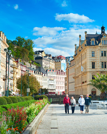 historically: KARLOVY VARY, CZECH REPUBLIC - SEPTEMBER 20, 2012: People walking along Hot springs colonnade in Karlovy Vary. Karlovy Vary historically famous for its hot springs (13 main springs, about 300 smaller)