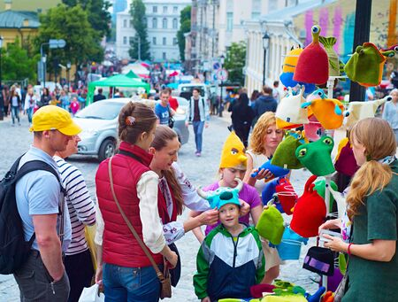 revellers: KIEV, UKRAINE - MAY 28, 2016: People at street market on Andrew descent during the Kiev Day. Day of Kiev is a holiday in the Ukrainian capital, usually celebrated in the last weekend of May.