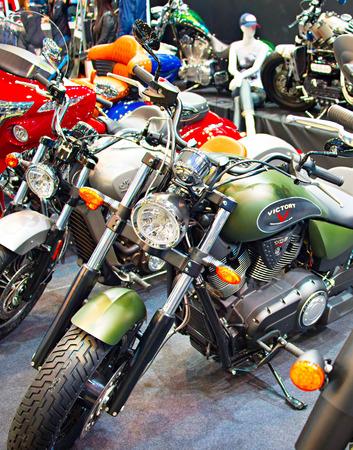 motobike: KIEV, UKRAINE - MARCH 13, 2016:  Row of retro and custom motorcycles on display at MotoBike 2016 Motor Show in Kiev, Ukraine. MotoBike is the largest annual motorcycle show in Ukraine. Editorial