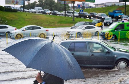 sharpness: Heavy rain in the city. Sharpness at umbrella