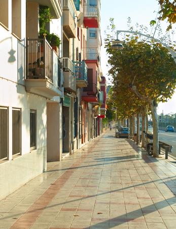 Beautiful sunny street of Barcelona suburb at sunrise. Spain