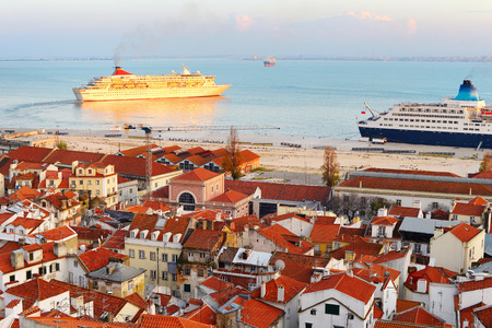 Cruise ships in Lisbon harbor at sunset. Portugal