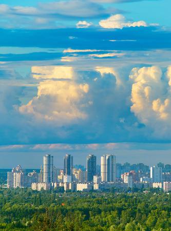 Beautiful view of city district under majestic clouds. Kiev, Ukraine