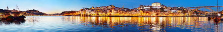 wine road: Panoramic view of Porto at twilight with reflection in Douro river. Portugal Stock Photo