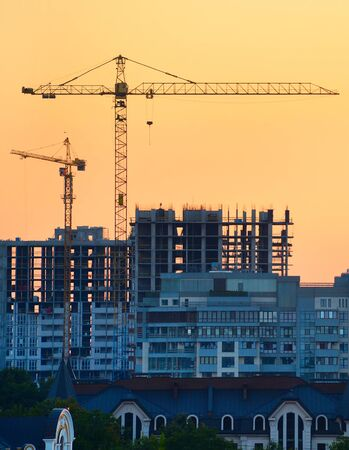 View of cranes at construction site in the city  Stock Photo